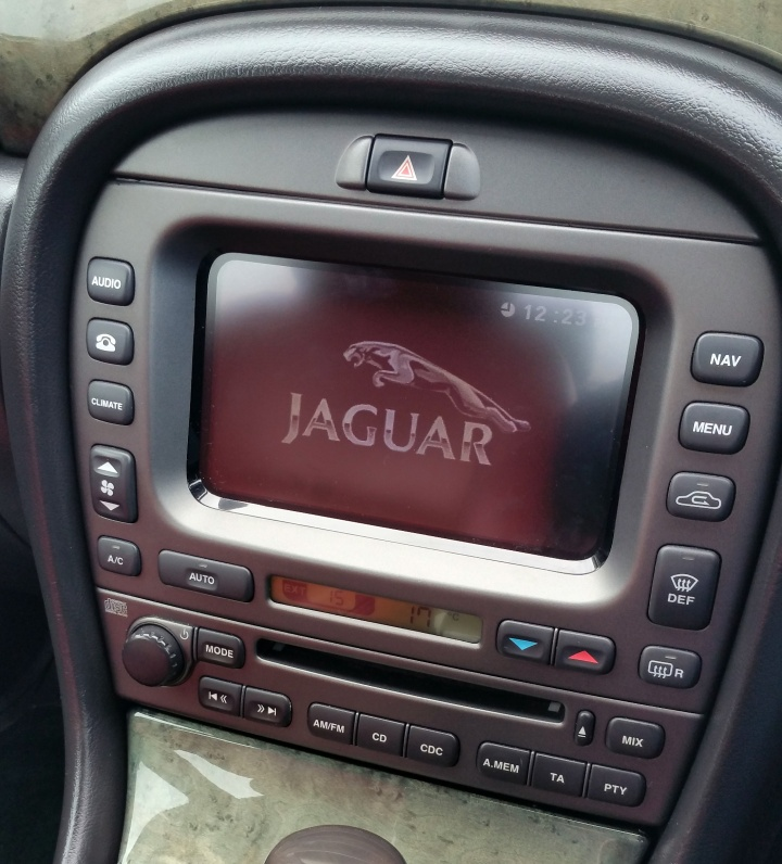 AC upgraded to Climate Control, and touchscreen and navigation system installed.